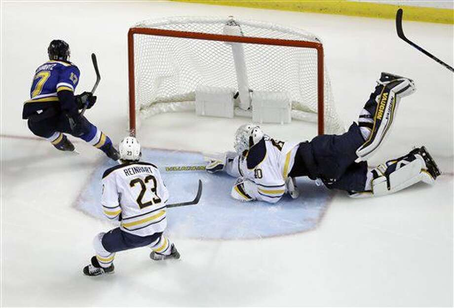St. Louis Blues' Jaden Schwartz, left, scores past Buffalo Sabres goalie Robin Lehner, of Sweden, and Sam Reinhart (23) during the third period of an NHL hockey game Tuesday, Nov. 15, 2016, in St. Louis. The Blues won 4-1. (AP Photo/Jeff Roberson)