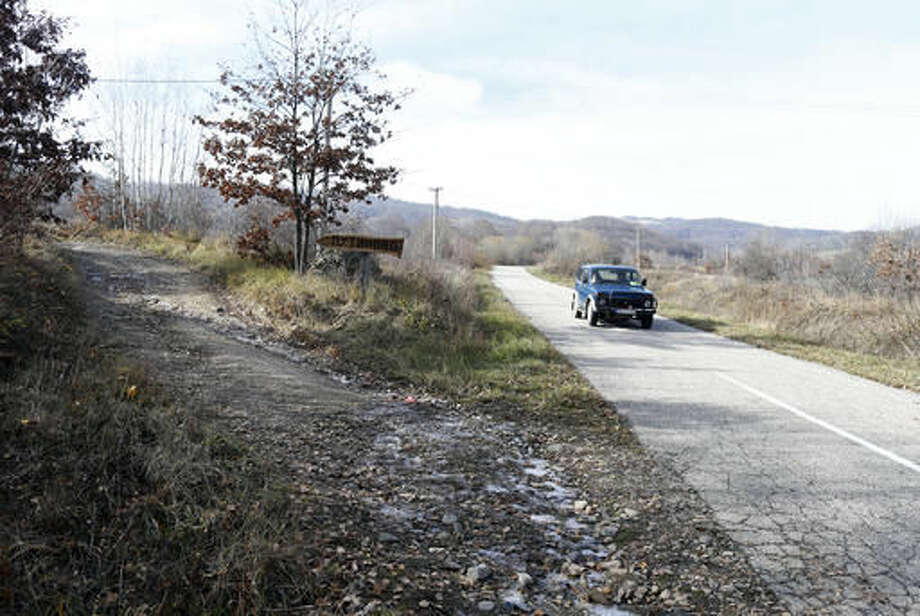 A car passes by a new appointed traffic sign reads 'Putinovo' or 'Putin's Village' in Serbian, a village that has been renamed after Russia's President Vladimir Putin, near the village of Adzince, about 250 kilometers (150 miles) south of Belgrade, Serbia, Wednesday, Nov. 16, 2016. Residents of a remote mountain hamlet in southern Serbia admire Vladimir Putin so much that they've decided to rename their village after the Russian president. (AP Photo/Darko Vojinovic)