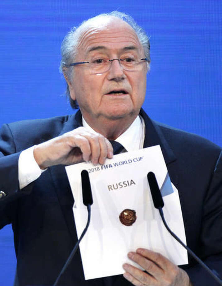 """FILE - This is a Thursday, Dec. 2, 2010 file photo of the then FIFA President Joseph Blatter as he announces Russia to host the 2018 World Cup during the announcement of the host country for the 2018 soccer World Cup in Zurich, Switzerland. Two years after details of a FIFA investigation into the 2018-2022 World Cup bid contests were first revealed, the so-called """"Garcia Report"""" from American lawyer Michael Garcia's team is still not close to being published for the scandal-scarred soccer body's critics to read. (AP Photo/Michael Probst, File)"""