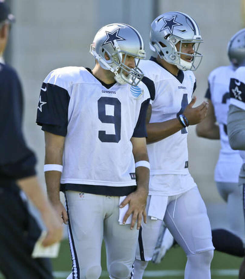 Dallas Cowboys starting quarterback Dak Prescott (4) and backup quarterback Tony Romo (9) stand on the field during an NFL football team practice in Frisco, Texas, Wednesday, Nov. 16, 2016. Prescott frequently said the Dallas Cowboys were still Romo's team even when the rookie had early success. But now the 36-year-old has declared himself the backup, leaving no doubt it's Prescott's team. (AP Photo/LM Otero)
