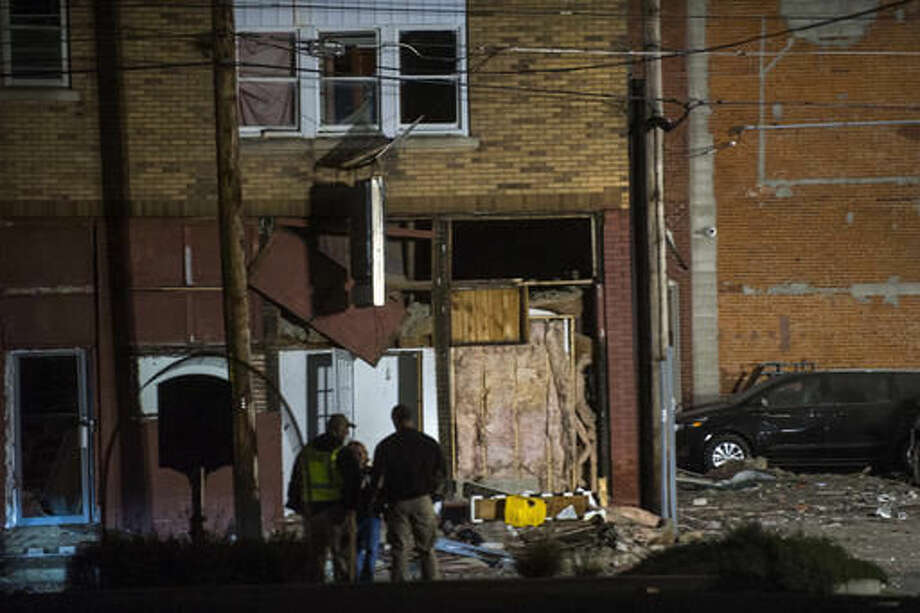 An explosion damaged several buildings near the downtown square in Canton, Ill., Wednesday evening, Nov. 16, 2016. Authorities say one person was killed and several people injured in a natural gas explosion in the central Illinois community of Canton. The Peoria Journal Star reported the explosion occurred just before 6 p.m. in a building along First Avenue. (Lewis Marien/The Journal-Star via AP)