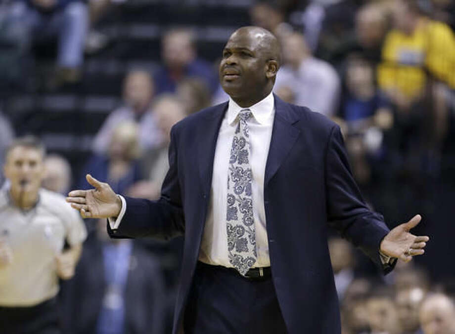 Indiana Pacers coach Nate McMillan reacts during the first half of the team's NBA basketball game against the Cleveland Cavaliers in Indianapolis, Wednesday, Nov. 16, 2016. (AP Photo/Michael Conroy)