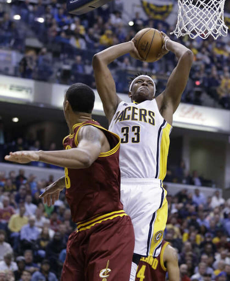Indiana Pacers center Myles Turner (33) hoes up for a dunk over Cleveland Cavaliers forward Channing Frye during the second half of an NBA basketball game in Indianapolis, Wednesday, Nov. 16, 2016. The Pacers won 103-93. (AP Photo/Michael Conroy)