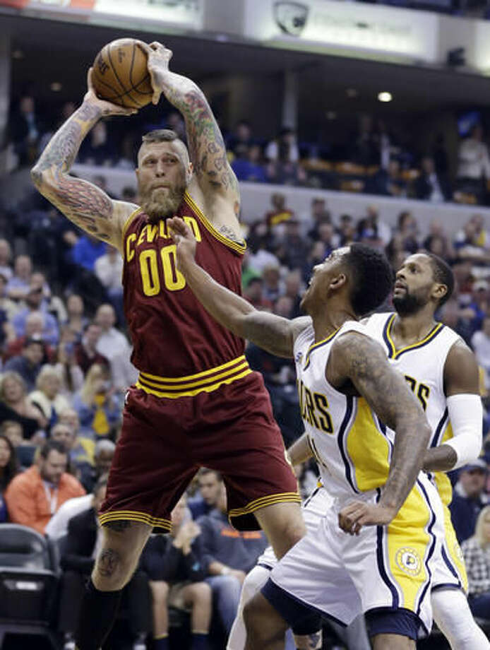 Cleveland Cavaliers forward Chris Andersen (00) grabs a rebound over Indiana Pacers guard Jeff Teague (44) during the first half of an NBA basketball game in Indianapolis, Wednesday, Nov. 16, 2016. (AP Photo/Michael Conroy)