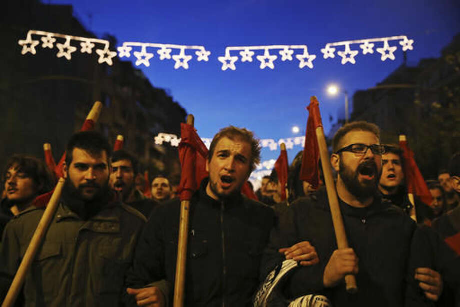 Demonstrators chant slogans as they march in central Athens, Thursday, Nov. 17, 2016. Several thousand people march to the U.S. Embassy in Athens under tight police security to commemorate a 1973 student uprising that was crushed by Greece's military junta, that ruled the country from 1967-74. (AP Photo/Yorgos Karahalis)