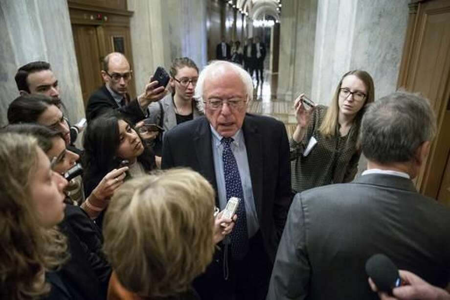 FILE - In this Nov. 16, 2016 file photo, Sen. Bernie Sanders, I-Vt. speaks to reporters on Capitol Hill in Washington. Sanders is calling on Donald Trump to apologize for some of his controversial rhetoric during the presidential campaign and asking him cut ties with campaign CEO Steve Bannon. (AP Photo/Andrew Harnik, File)