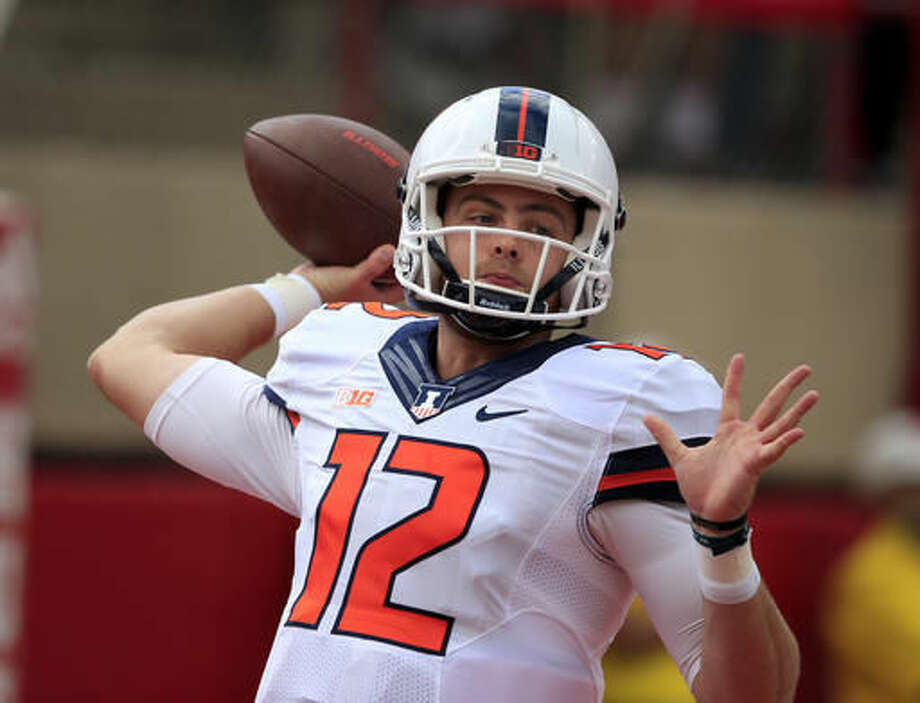 FILE - In this Saturday, Oct. 1, 2016 file photo, Illinois quarterback Wes Lunt (12) warms up before an NCAA college football game against Nebraska in Lincoln, Neb. Lunt returned from injury in last week's loss to Wisconsin. His offensive line hasn't given up a sack in two games. (AP Photo/Nati Harnik, File)