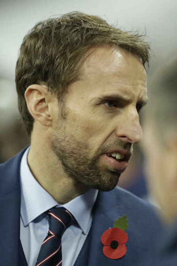 England's interim manager Gareth Southgate wears a poppy to mark Armistice Day during the World Cup group F qualifying soccer match between England and Scotland at the Wembley stadium, London, Friday, Nov. 11, 2016. (AP Photo/Matt Dunham)
