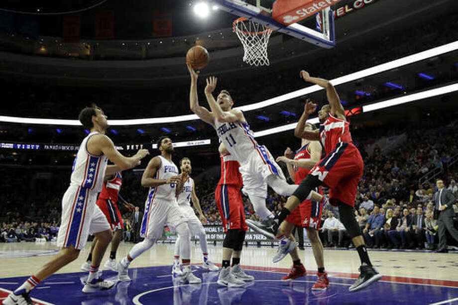 Philadelphia 76ers' Nik Stauskas (11) goes up for a shot during the second half of an NBA basketball game against the Washington Wizards, Wednesday, Nov. 16, 2016, in Philadelphia. Philadelphia won 109-102. (AP Photo/Matt Slocum)