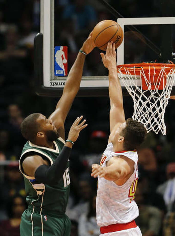 Atlanta Hawks forward Kris Humphries (43) blocks Milwaukee Bucks center Greg Monroe's (15) shot in the first half of an NBA basketball game Wednesday, Nov. 16, 2016, in Atlanta. (AP Photo/John Bazemore)