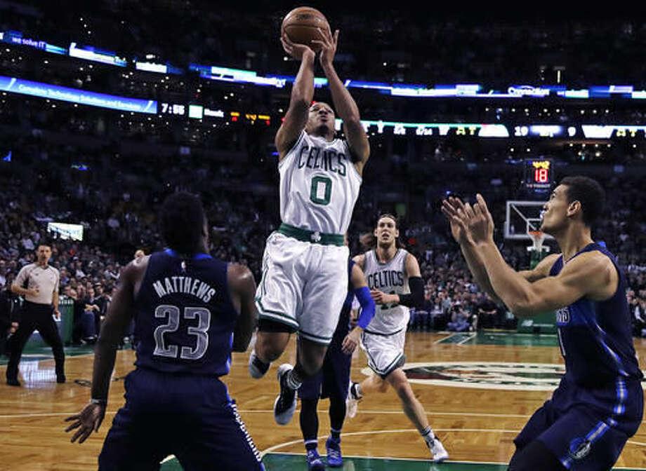 Boston Celtics guard Avery Bradley (0) shoots against the Dallas Mavericks during the first quarter of an NBA basketball game in Boston, Wednesday, Nov. 16, 2016. (AP Photo/Charles Krupa)