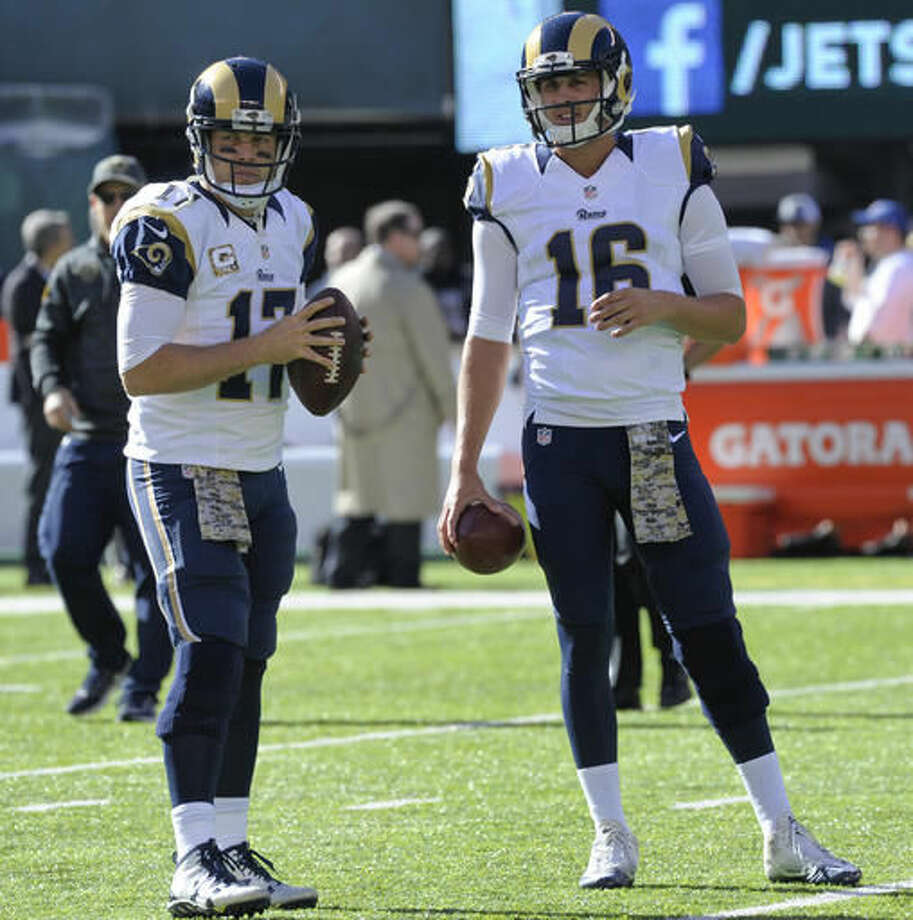 FILE - In this Nov. 13, 2016, file photo, Los Angeles Rams quarterbacks Case Keenum (17) and Jared Goff (16) warm up before an NFL football game against the New York Jets, in East Rutherford, N.J. A person with knowledge of the decision tells The Associated Press that quarterback Jared Goff will make his NFL debut on Sunday when the No. 1 pick starts for the Los Angeles Rams. The source spoke on condition of anonymity Tuesday, Nov. 15, 2016, because Rams coach Jeff Fisher hadn't made the official announcement. (AP Photo/Bill Kostroun, File)
