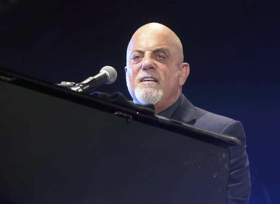 """FILE - In this July 25, 2015, file photo, singer-songwriter Billy Joel performs in concert at M&T Bank Stadium in Baltimore. Joel is supporting a crowdfunding campaign for a local documentary examining the plight of Oyster Bay's natural shell fishermen. Newsday reported the Rock and Roll Hall of Famer has key roles in """"The Bay of Imbalance"""" and is listed as a content contributor on the website seeking donations for the film. (Photo by Owen Sweeney/Invision/AP, File)"""