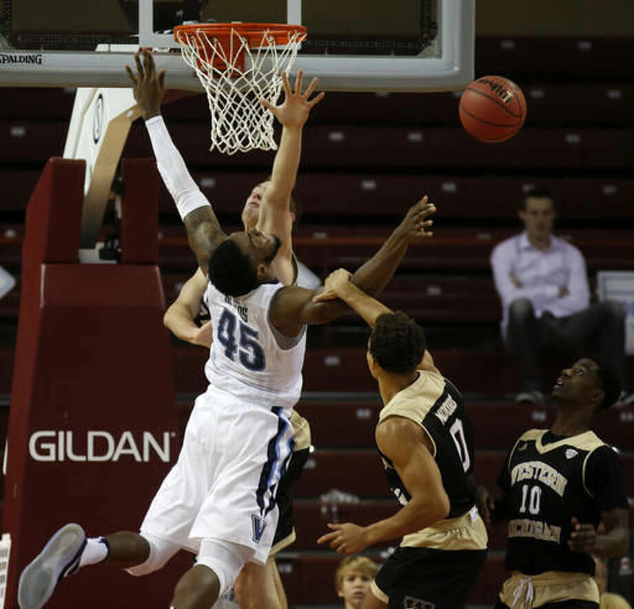 Villanova's Darryl Reynolds (45) is fouled by Western Michigan's Bryce Moore (0) during the first half of an NCAA college basketball game at the Charleston Classic at TD Arena, Thursday Nov. 17, 2016, in Charleston, S.C. (AP Photo/Mic Smith)