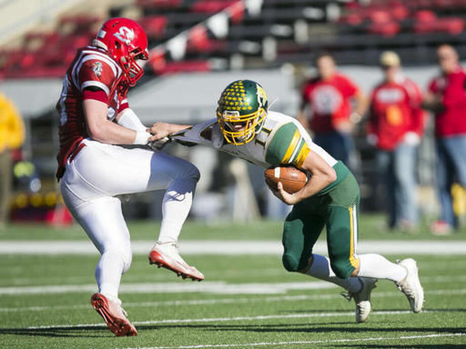 Shullsburg's Joseph Meyer, left, tackles Edgar quarterback Karson Butt during the first half of the WIAA Division 7 high school football championship game Thursday, Nov. 17, 2016, in Madison, Wis. (AP Photo/Andy Manis)
