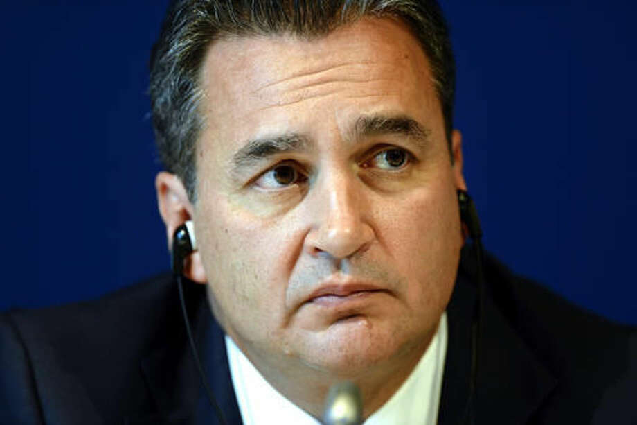 """FILE - This is a Friday, 27. July 2012, file photo of Chairman of the two chambers of the new FIFA Ethics Committee Michael Garcia from the US during a press conference at the Home of FIFA in Zurich, Switzerland. Two years after details of a FIFA investigation into the 2018-2022 World Cup bid contests were first revealed, the so-called """"Garcia Report"""" from American lawyer Michael Garcia's team is still not close to being published for the scandal-scarred soccer body's critics to read. (AP Photo/Keystone, Walter Bieri, File)"""