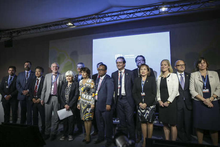 Ministers of environment pose together for a photo at the launch of the 2050 Pathways Platform, at the COP22 climate change conference, in Marrakech, Morocco, Thursday, Nov. 17, 2016. Governments around the world are being asked to commit to reduce their national greenhouse gas emissions by at least 80% by 2050, relative to 1990 levels. (AP Photo/Mosa'ab Elshamy)