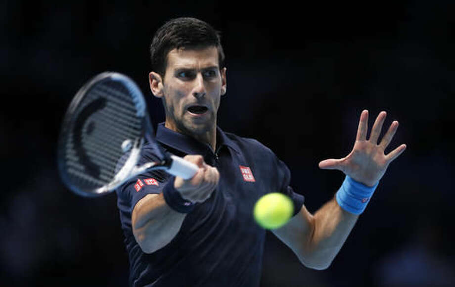 Novak Djokovic of Serbia plays a return to David Goffin of Belgium during their ATP World Tour Finals singles tennis match at the O2 Arena in London, Thursday, Nov. 17, 2016. (AP Photo/Kirsty Wigglesworth)