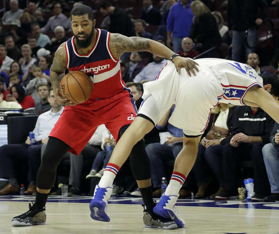 Philadelphia 76ers' Ersan Ilyasova, right, falls after a foul by Washington Wizards' Markieff Morris during the first half of an NBA basketball game, Wednesday, Nov. 16, 2016, in Philadelphia. (AP Photo/Matt Slocum)