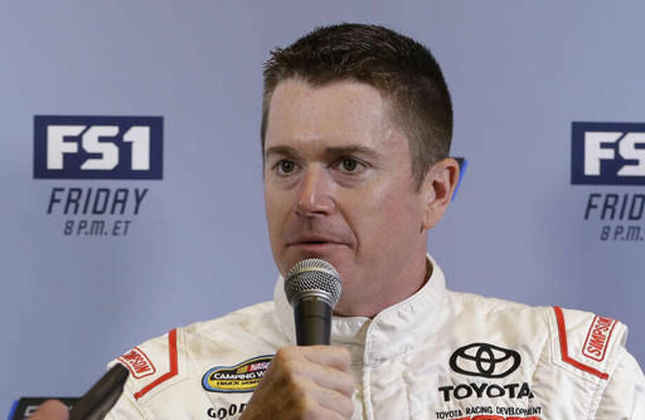 NASCAR Camping World Truck Series driver Timothy Peters talks to a reporter at NASCARs annual media event Thursday, Nov. 17, 2016, in Miami Beach, Fla. (AP Photo/Alan Diaz)