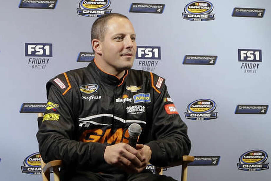 NASCAR Camping World Truck Series driver Johnny Sauter listens to a question from a reporter at NASCARs annual media event Thursday, Nov. 17, 2016, in Miami Beach, Fla. (AP Photo/Alan Diaz)