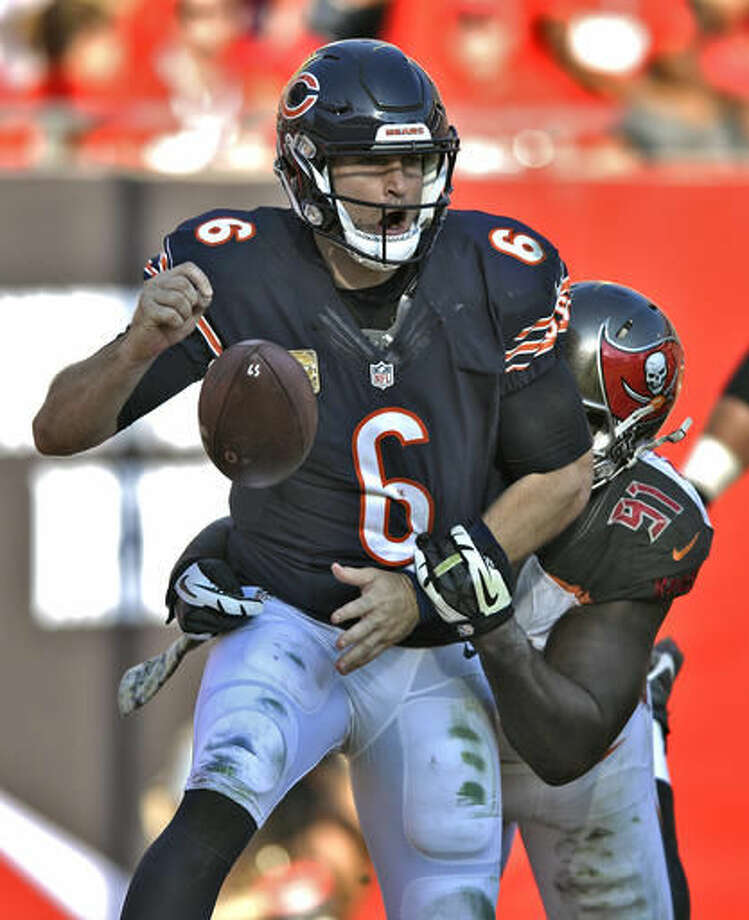 Chicago Bears quarterback Jay Cutler (6) fumbles as he is hit by Tampa Bay Buccaneers defensive end Robert Ayers (91) in the end zone during the third quarter of an NFL football game Sunday, Nov. 13, 2016, in Tampa, Fla. Cutler fumbled out of bounds resulting in a safety. (AP Photo/Jason Behnken)