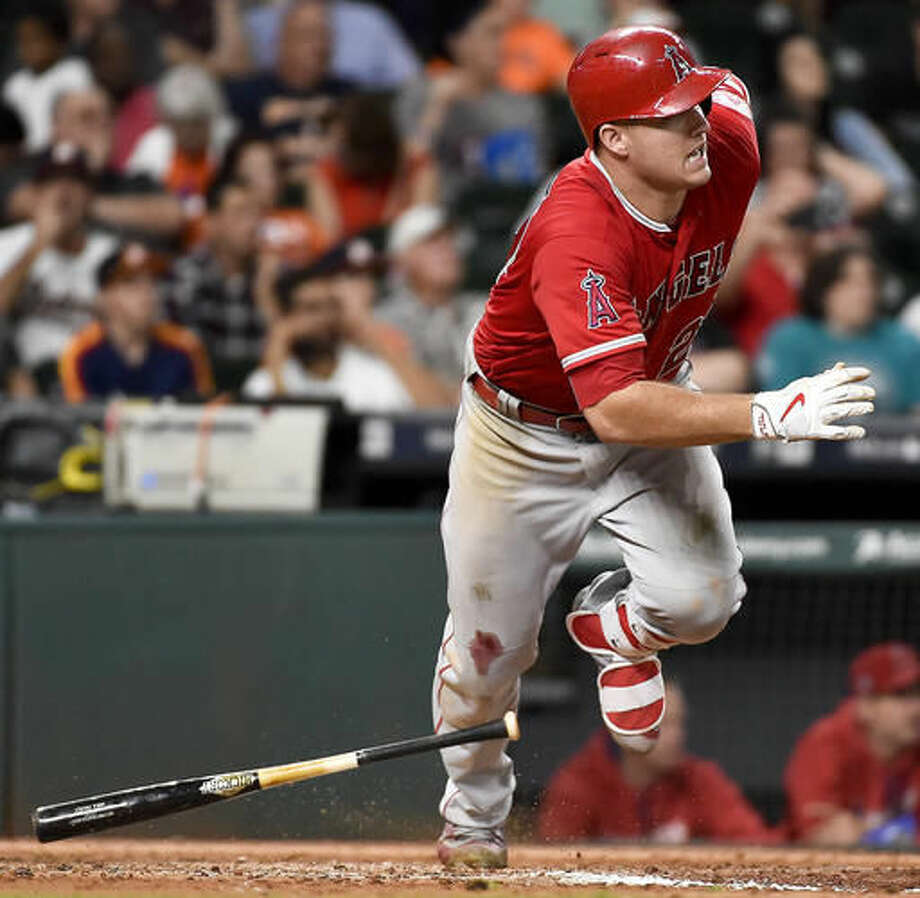 FILE - In this Sept. 24, 2016, file photo, Los Angeles Angels' Mike Trout watches his RBI-single in the eighth inning of a baseball game against the Houston Astros, in Houston. Trout, Mookie Betts and Jose Altuve are the finalists for the American League Most Valuable Player award. (AP Photo/Eric Christian Smith, File)