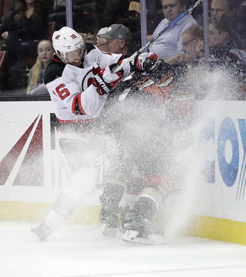 New Jersey Devils' Jacob Josefson, left, of Sweden, collides with Anaheim Ducks' Nick Ritchie during the second period of an NHL hockey game Thursday, Nov. 17, 2016, in Anaheim, Calif. (AP Photo/Jae C. Hong)