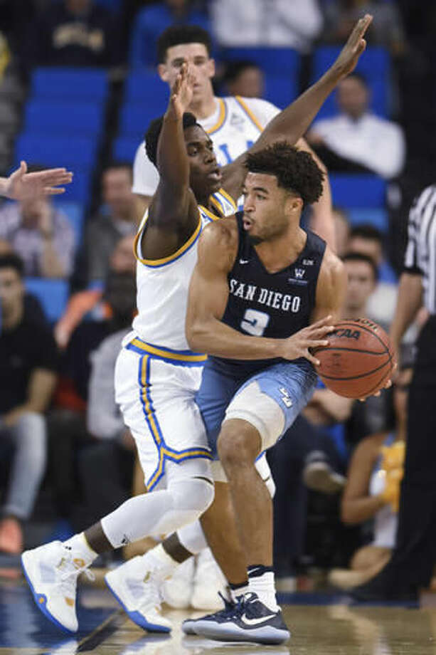 UCLA's Aaron Holiday pressures San Diego's Olin Carter III during the first half of an NCAA college basketball game in Los Angeles, Thursday, Nov. 17, 2016. (AP Photo/Michael Owen Baker)