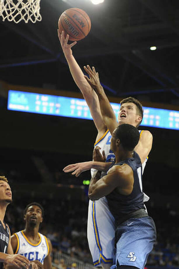 UCLA's TJ Leaf powers into the lane for a shot over San Diego's Nassir Barrino during the first half of an NCAA college basketball game in Los Angeles, Thursday, Nov. 17, 2016. (AP Photo/Michael Owen Baker)