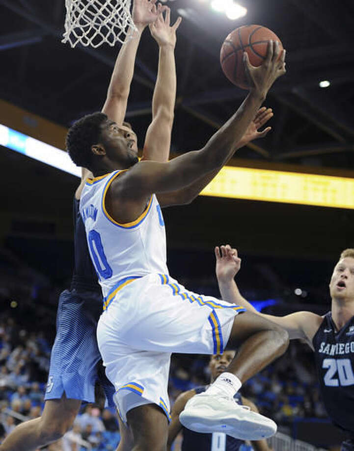 UCLA's Isaac Hamilton drives under the basket for a reverse layup against San Diego during an NCAA college basketball game in Los Angeles, Thursday, Nov. 17, 2016. (AP Photo/Michael Owen Baker)