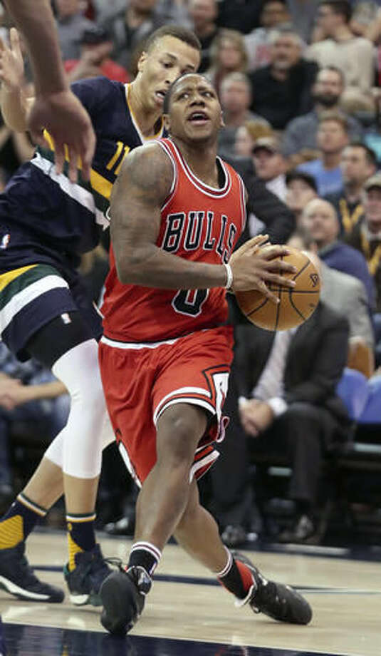 Chicago Bulls guard Isaiah Canaan, right, drives past Utah Jazz guard Dante Exum, left, during the first half at an NBA basketball game on Thursday, Nov. 17, 2016, in Salt Lake City. (AP Photo/George Frey)