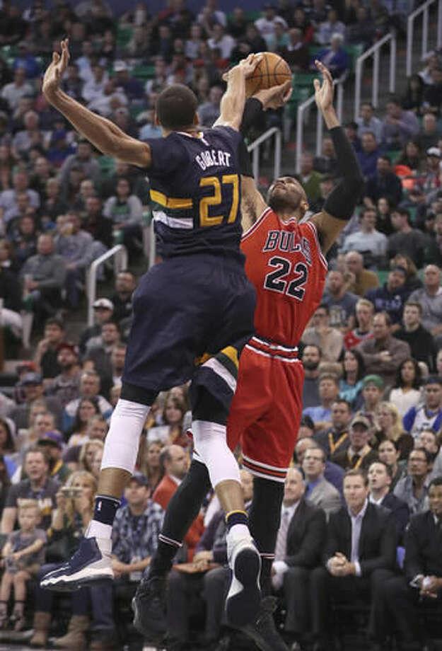 Utah Jazz center Rudy Gobert, left, blocks the shot of Chicago Bulls forward Taj Gibson, right, during the first half at an NBA basketball game Thursday, Nov. 17, 2016, in Salt Lake City. (AP Photo/George Frey)