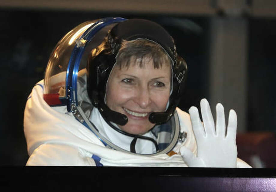 U.S. astronaut Peggy Whitson, member of the main crew of the expedition to the International Space Station (ISS), gestures from a bus prior the launch of Soyuz MS-3 space ship at the Russian leased Baikonur cosmodrome, Kazakhstan, Thursday, Nov. 17, 2016. (AP Photo/Dmitri Lovetsky, Pool)