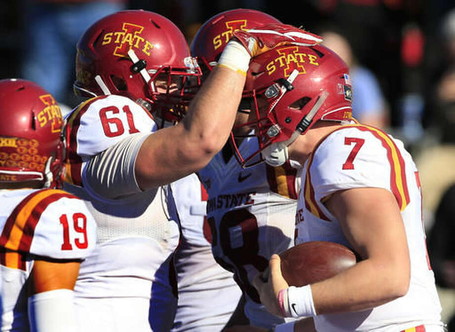 Iowa State quarterback Joel Lanning (7) is congratulated by teammate Brian Bobek (61) after scoring a touchdown during the second half of an NCAA college football game against Kansas in Lawrence, Kan., Saturday, Nov. 12, 2016. Iowa State defeated Kansas 31-24. (AP Photo/Orlin Wagner)