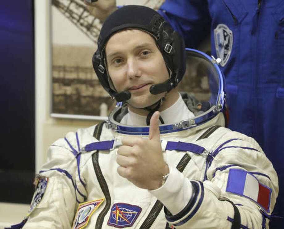 French astronaut Thomas Pesquet member of the main crew of the expedition to the International Space Station (ISS), gestures prior the launch of Soyuz MS-03 space ship at the Russian leased Baikonur cosmodrome, Kazakhstan, Thursday, Nov. 17, 2016. (AP Photo/Dmitri Lovetsky)