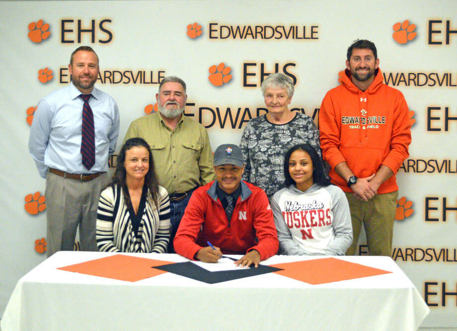 Edwardsville senior Travis Anderson will run track and field for the Nebraska Cornhuskers. Seated in the front row from left to right are Gina Dycus, mother, Travis Anderson and Amayah Dycus, sister. Back row from left to right are EHS head coach Chad Lakatos, Jim Dycus, grandfather, Carla Dycus, grandmother and EHS assistant coach Alec Holler.