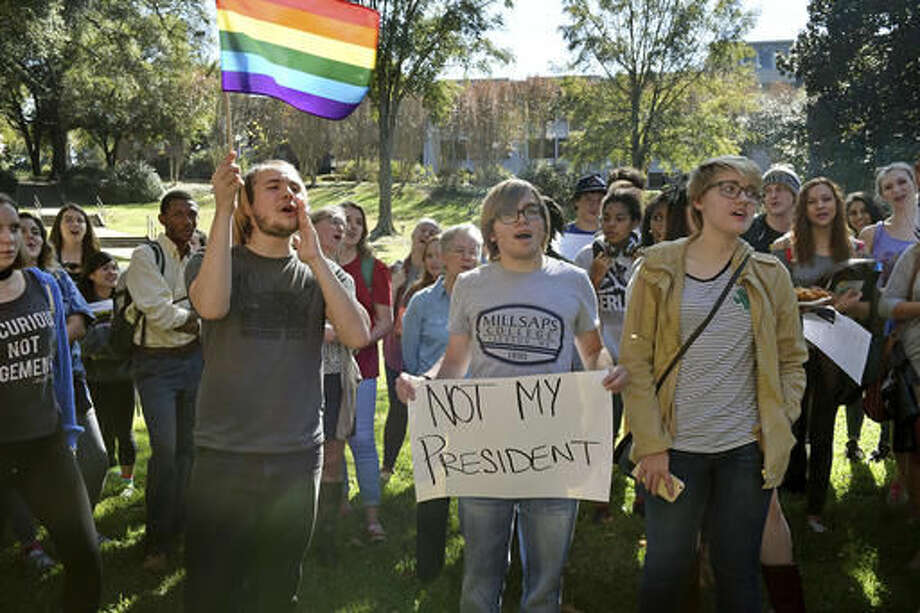 Millsaps College student Devin Black, center, holds a sign during a protest of the election of President-elect Donald Trump at Millsaps College Wednesday, Nov. 16, 2016, in Jackson, Miss. (Elijah Baylis/The Clarion-Ledger via AP)