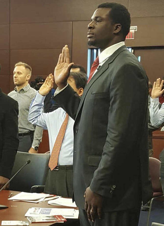 In this photo provided by the U.S. Citizenship and Immigration Services, Buffalo Bills offensive lineman Cyrus Kouandjio takes the oath to become an American citizen, Thursday Nov. 17, 2016, during a ceremony in U.S. District Court in Buffalo, N.Y. Kouandjio was born in Cameroon and came to the United States with his parents, who settled in Maryland. (U.S. Citizenship and Immigration Services/Anita Moore via AP)