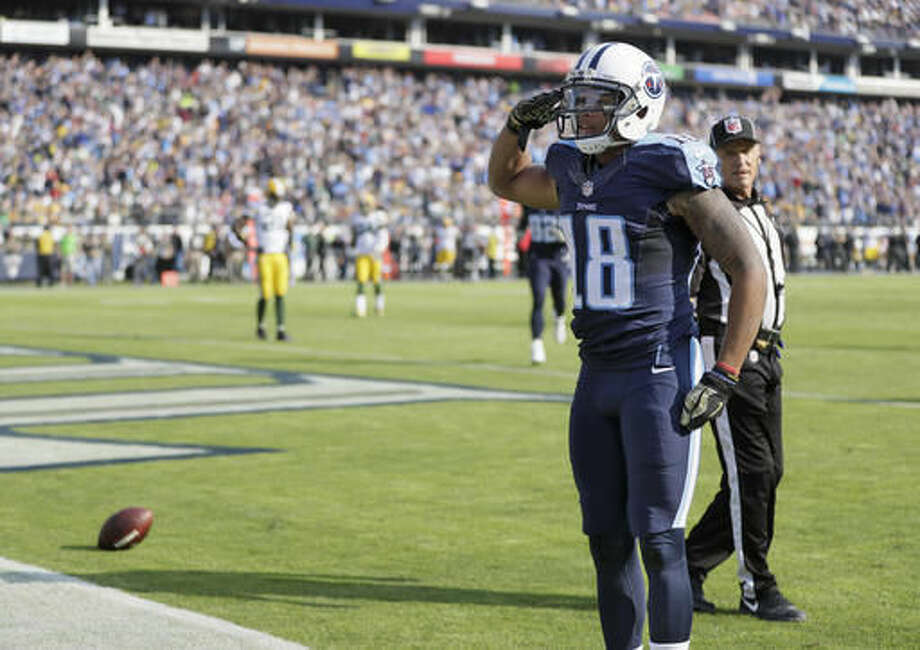 FILE - In this Nov. 13, 2016 file photo, Tennessee Titans wide receiver Rishard Matthews celebrates after scoring a touchdown against the Green Bay Packers in an NFL football game in Nashville, Tenn. Matthews now has six touchdowns over his past six games as Tennessee prepares to visit Indianapolis, Sunday, Nov. 20, 2016. (AP Photo/James Kenney, File)