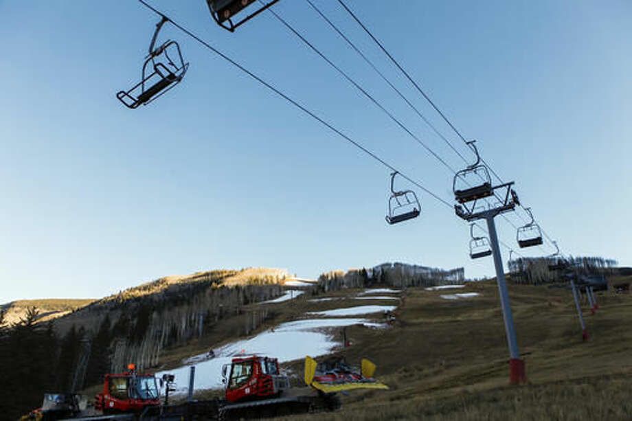 Ski operations sit on stand-by on Tuesday, Nov. 15, 2016, in Vail, Colo. The mountain was supposed to open Friday, Nov. 18, but Vail Resorts has pushed back the opening to Friday, Nov. 25. Autumn snow has been scarce in the Rocky Mountains, forcing some ski areas to push back opening day and causing some nervousness about how much water will be available next spring for the Colorado River. (Chris Dillmann/Vail Daily via AP)