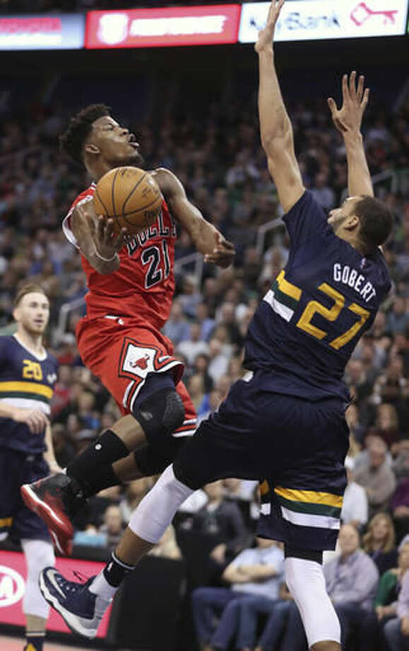 Chicago Bulls forward Jimmy Butler, left, shoots as Utah Jazz center Rudy Gobert, left, defends during the first half at an NBA basketball game on Thursday, Nov. 17, 2016, in Salt Lake City. (AP Photo/George Frey)