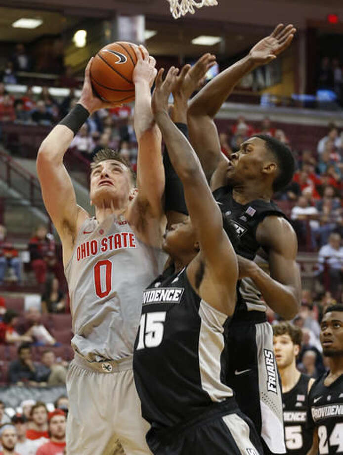 Ohio State's Micah Potter, left, shoots against Providence's Emmitt Holt, center, and Rodney Bullock during the second half of an NCAA college basketball game Thursday, Nov. 17, 2016, in Columbus, Ohio. (AP Photo/Jay LaPrete)