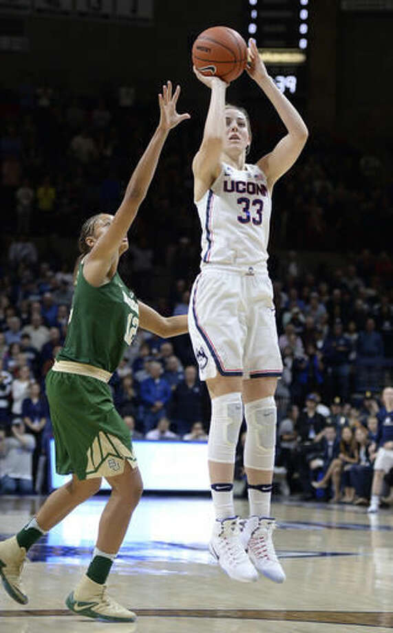 Connecticut's Katie Lou Samuelson shoots as Baylor's Alexis Prince, left, defends in the first half of an NCAA college basketball game, Thursday, Nov. 17, 2016, in Storrs, Conn. (AP Photo/Jessica Hill)