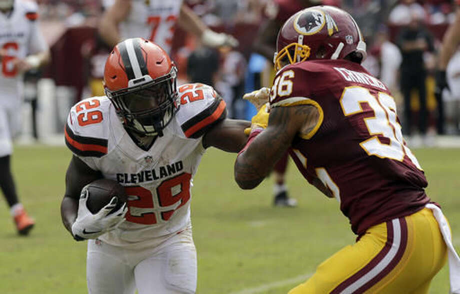 """In this photo taken Oct. 2, 2016, Washington Redskins defensive back Su'a Cravens (36) attempts to tackle Cleveland Browns running back Duke Johnson (29) during the first half of an NFL football game in Landover, Md. Cravens figured out a few practices into his NFL career what life in the trenches was like. """"I was about 217 pounds playing (middle) linebacker with no pads on going against guys like (tackles Ty Nsekhe and Trent Williams),"""" Cravens recalled, """"and I didn't know Trent was as fast as me so I got thrown out the club about three or four times in the first couple OTA practices before I was like, 'OK let me just make a decision and live with it.'"""" (AP Photo/Mark Tenally)"""