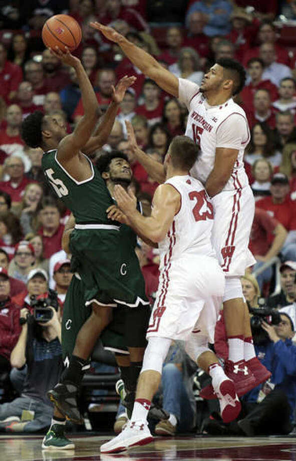 Wisconsin forward Charles Thomas IV (15) defends a shot by Chicago State guard Trayvon Palmer (15) during the first half of an NCAA college basketball game in Madison, Wis., Thursday, Nov. 17, 2016. (Michael P. King/Wisconsin State Journal via AP)