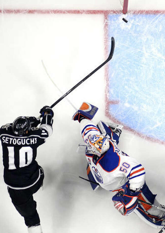Los Angeles Kings right wing Devin Setoguchi, left, scores on Edmonton Oilers goalie Jonas Gustavsson, of Sweden, during the third period of an NHL hockey game, Thursday, Nov. 17, 2016, in Los Angeles. The Kings won 4-2. (AP Photo/Mark J. Terrill)