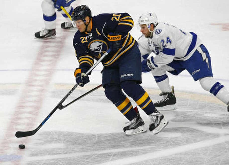 Buffalo Sabres forward Kyle Okposo (21) skates past Tampa Bay Lightning forward Ryan Callahan (24) during the second period of an NHL hockey game, Thursday, Nov. 17, 2016, in Buffalo, N.Y. (AP Photo/Jeffrey T. Barnes)
