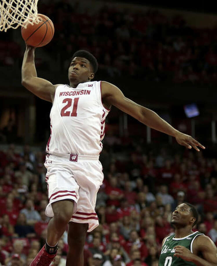 Wisconsin guard Khalil Iverson dunks the ball on a fast break past Chicago State guard Glen Burns (0) during the first half of an NCAA college basketball game in Madison, Wis., Thursday, Nov. 17, 2016. (Michael P. King/Wisconsin State Journal via AP)