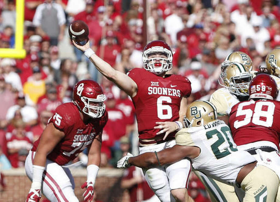 Oklahoma quarterback Baker Mayfield (6) passes against Baylor during the second half of a NCAA college football game in Norman, Okla. on Saturday, Nov. 12, 2016. Oklahoma won 45-24. (AP Photo/Alonzo Adams)